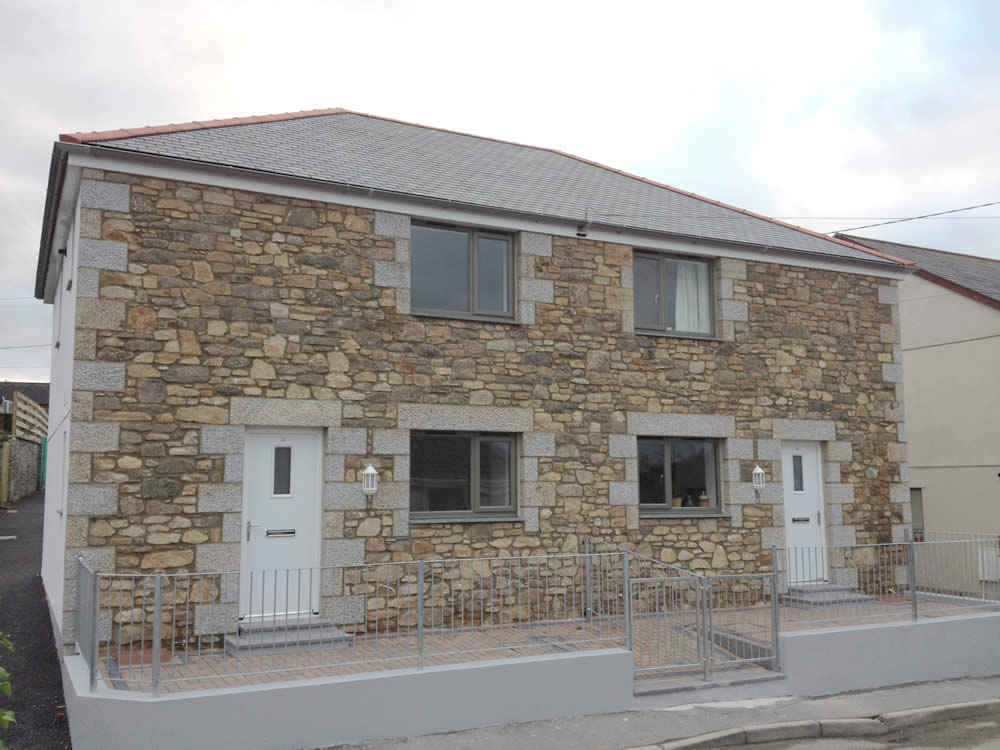 Granite fronted 2 bed semi's new build in Helston by M2 Developments Ltd